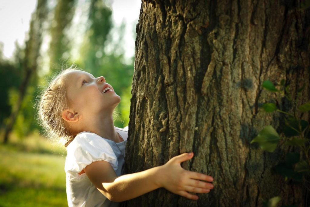 Trees - Girl Hugging a Tree